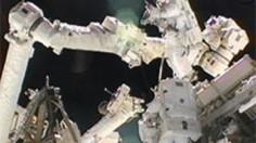 Spacewalkers Sunita Williams and Akihiko Hoshide work outside the International Space Station.