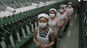 Workers Work At A Garment Factory In Shanghai