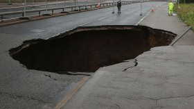 Sinkhole in one of the busy streets in Britain, What causes these phenomena?