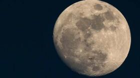 A Plane Is Dwarfed As It Flies Past The Moon