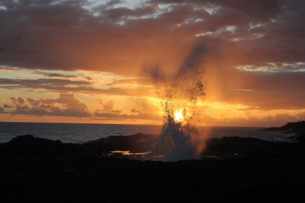 Spouting Horn blow hole at sunset.