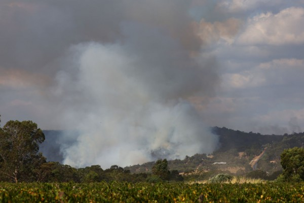 Firefighters Continue To Work To Control Bushfires Burning Across Perth Hills