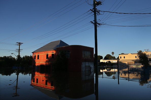A house surrounded by flood water