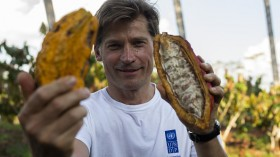 A man holding cocoa pods