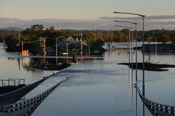 Bridge submerged under rising floodwaters