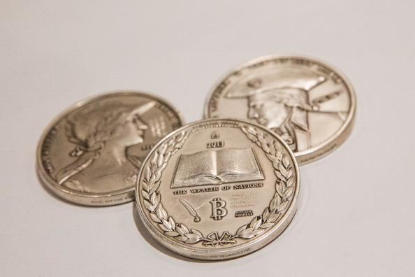 Silver coins with the Bitcoin logo