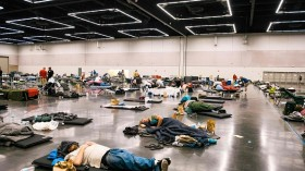 Portland residents resting at a convention cooling center due to the heat wave