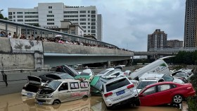 Cars trapped in floodwaters after heavy rains hit the city of Zhengzhou