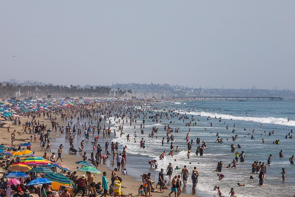 People cooling off at the beach due to the heat wave