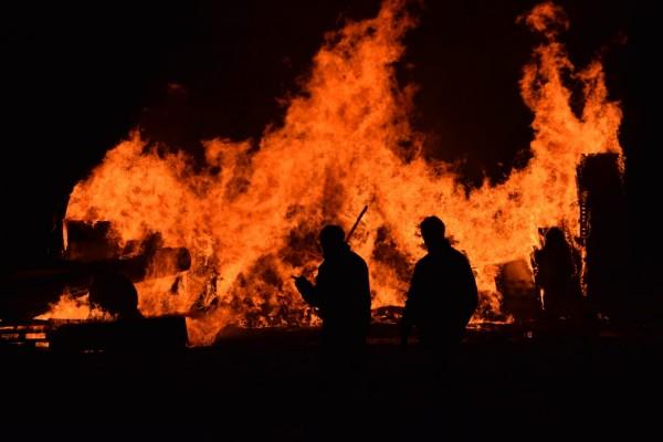 People walking around fire