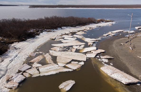 Melting ice beside severe erosion of a permafrost