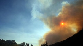 Smoke from a brush fire covers the sun in  California
