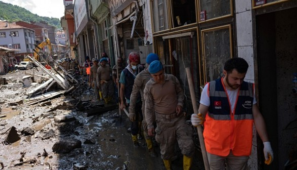 Soldiers and rescuers arrive to help clear the debris after the Ezine river broke it's banks during flash floods in Bozkurt