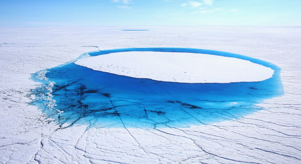 Water is seen on part of the glacial ice sheet, Greenland