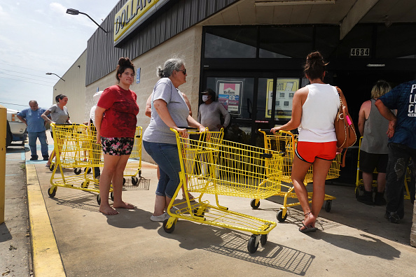 People wait in line to buy supplies in Louisiana