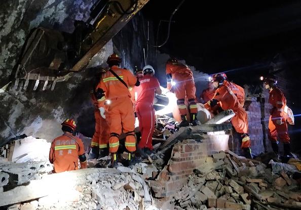 Rescuers search for earthquake survivors