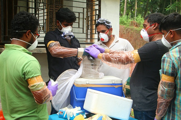 Animal Husbandry department and Forest officials deposit a bat into a container after catching it inside a well