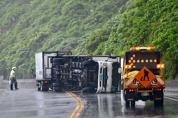 Typhoon Chanthu prompt a vehicle in New Taipei City to overturn as it approaches