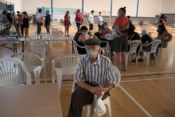 A man from a neighbouring town at a sports center in Ronda after he was evacuated from his home because of the fire