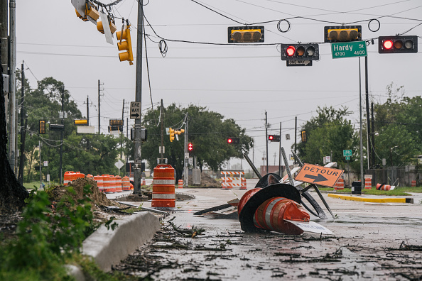 Debris and damaged road construction are left after Tropical Storm Nicholas moved through Texas