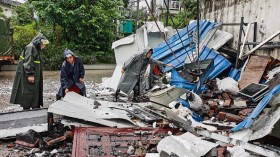 Rescuers clean up debris after an earthquake that killed three and injured a dozen in Luzhou