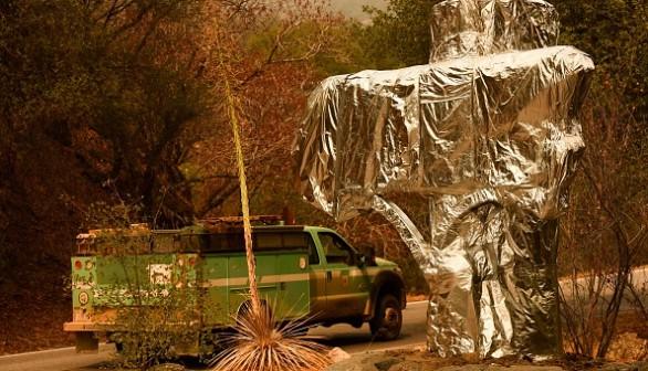 Sequoia National Park historic park entrance sign wrapped in fire resistant foil