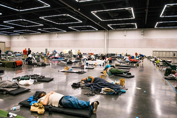 People resting at a cooling station in Oregon due to heatwave