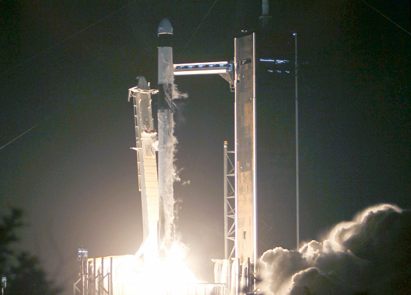 The SpaceX Falcon 9 rocket and Crew Dragon lift-off from launch Pad 39A at NASA's Kennedy Space Center