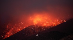 The Cumbre Vieja volcano in El Paso spews lava as seen from Los Llanos de Aridane on the Canary island of La Palma