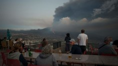 People watching the Cumbre Vieja volcano spews lava, ash and smoke