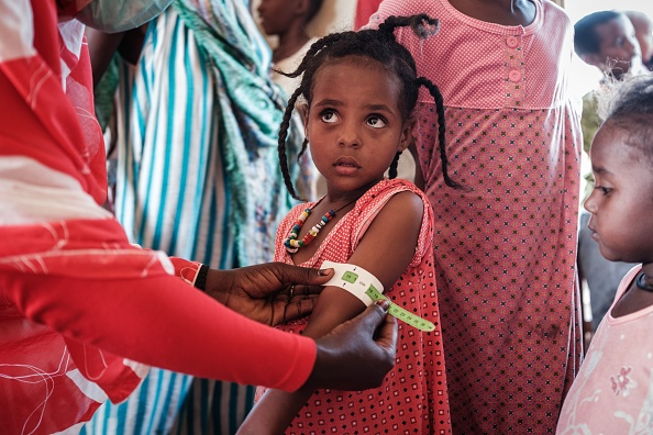 Girl measured at a malnutrition center