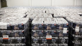 Pallets of bottled water are seen ready for distribution in a warehouse which is an emergency water supply for residents affected by lead-contaminat